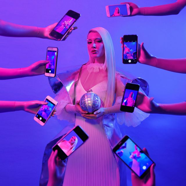 image: Devotional Shrines, dedicated to worshipping the phenomena of the feminine within the scope of new media. She lives her life surrounded by screens, be it gazing at them, inside of them, or both at the same time, examining what it means to exist between... by elirezkallah