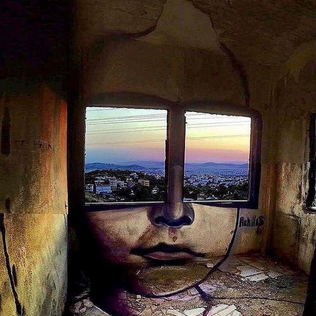 image: Achilles @mister.achilles - A pair of window shades overlook Greece (street art/spray paint) #misterachilles by durmoosh