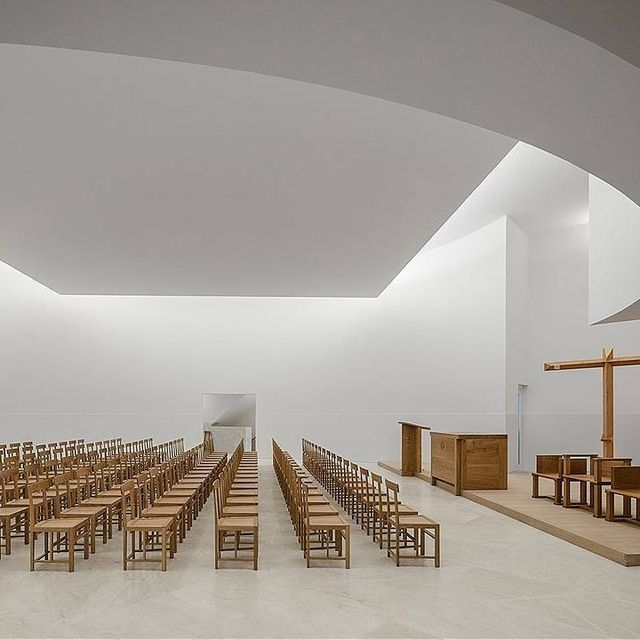 image: Famed Portuguese architect, Álvaro Siza Vieira (@sizavieira), has designed a modernist church whose poetic, sculptural form folds gently into the surrounding neighborhood in Rennes. See more on iGNANT.com by ignant