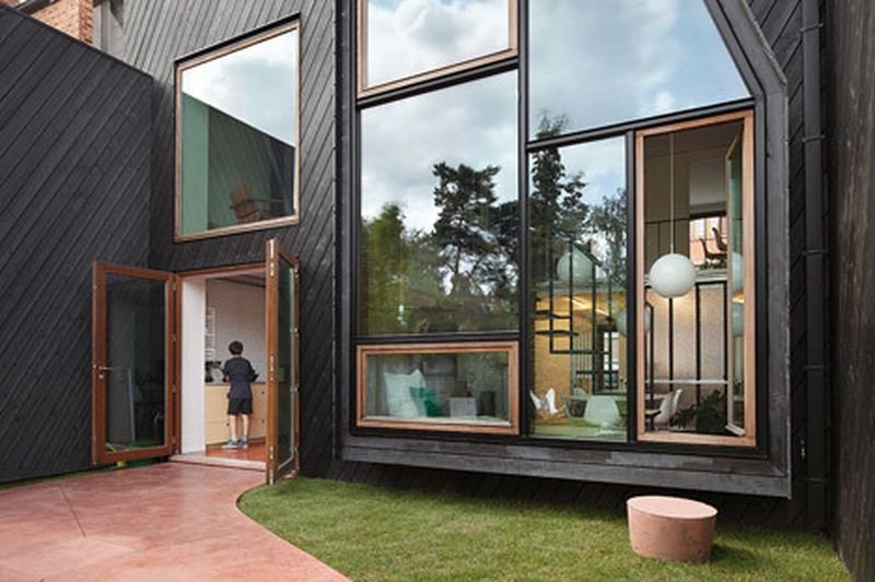 image: Assorted windows and diagonal cladding feature on re... by waryamaranth