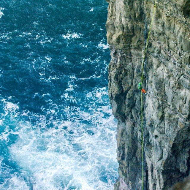 image: @colabcreative shot of me doing recon on a desperately pumpy route I'm working on here in The Faroe Islands. Pretty outrageous place for a ballistic adventure route! #faroenuff @thenorthface by cedarwright