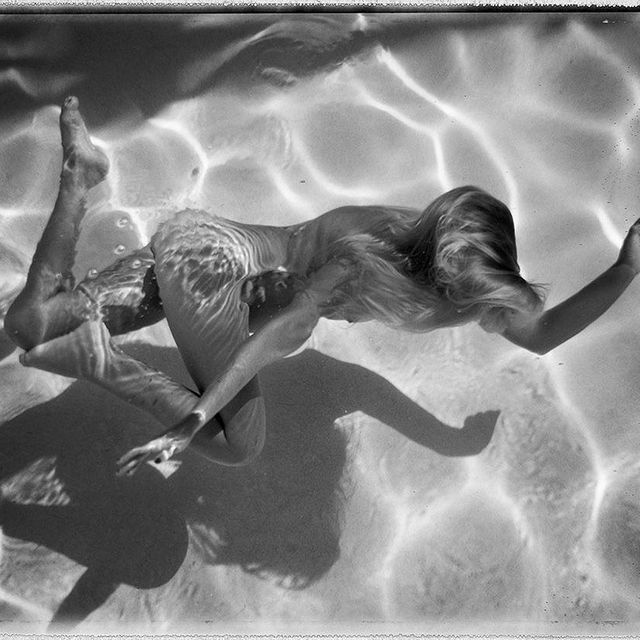 image: Californian street photographer @deannatempleton has photographed a collection of summer skinny-dippers in her backyard pool. See more on iGNANT.com #photography by ignant