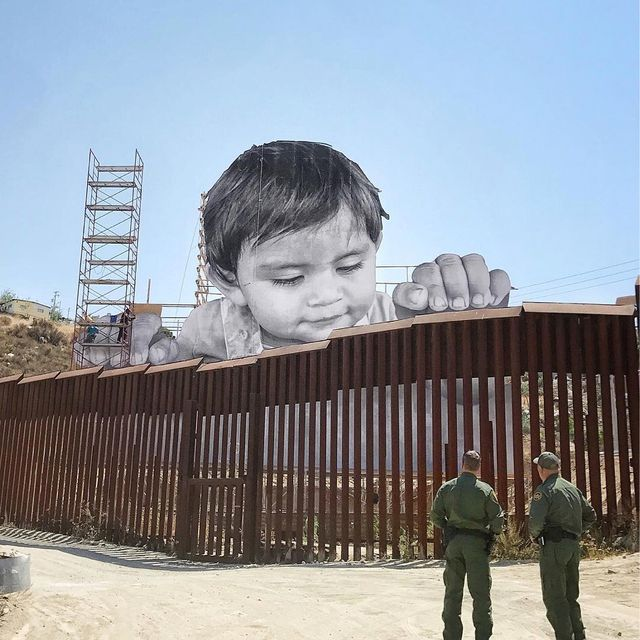 image: For his newest piece, artist and #TEDPrize winner JR created this massive, powerful installation. It depicts a one-year-old boy named Kikito curiously peeking over the US-Mexico border. The best view of the image is from Southern California — a view... by ted