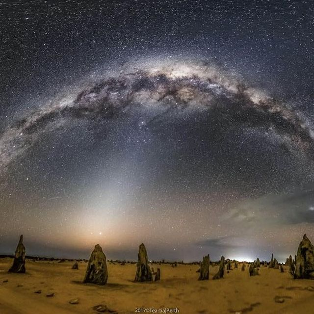image: What strange world is this? Earth. In the foreground of the featured image are the Pinnacles, unusual rock spires in Nambung National Park in Western Australia. Made of ancient sea shells (limestone), how these human-sized picturesque spires formed... by astronomypicturesdaily
