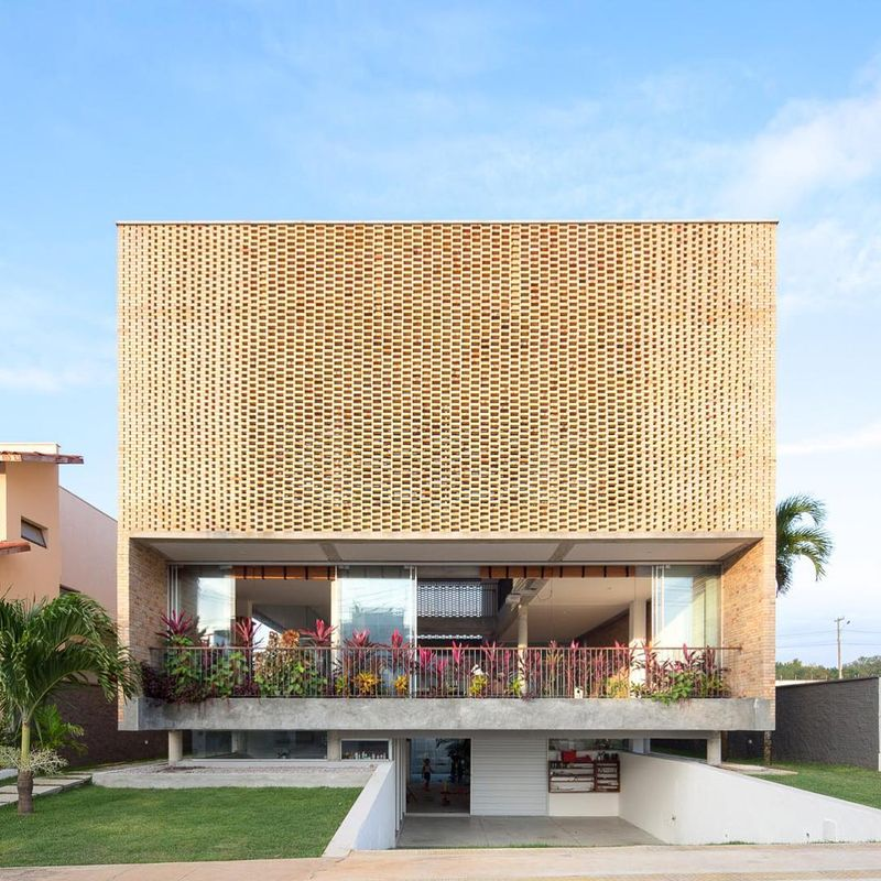 image: KS HOUSE by Arquitetos Associados is our #ProjectOfTheDay/ Located in Natal, Brazil, the home responds to the clients' desire for privacy, while granting them a large three-story internal void and openings are created in the façade through different... by architizer