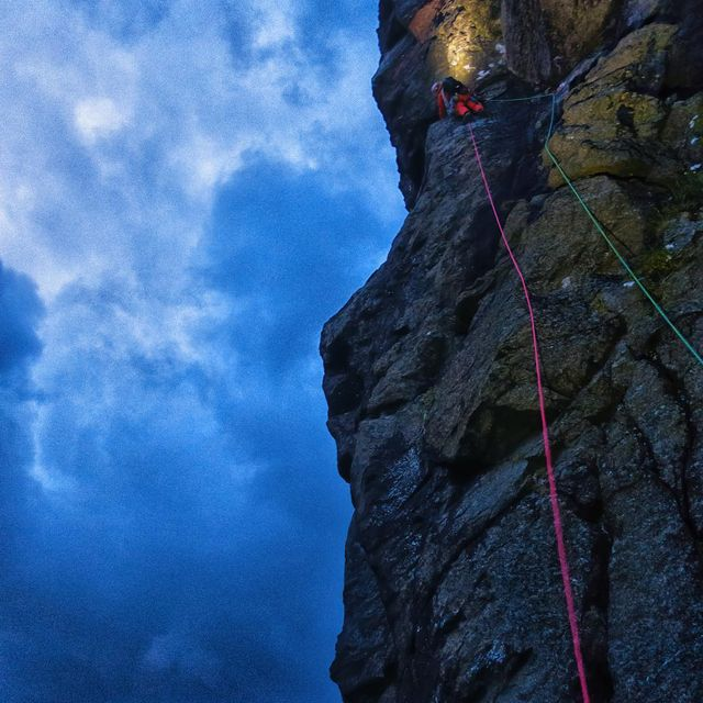 """image: Cape Enniberg: 754 meters high, long stretches of vertical grass, tens of thousands of Fulmars...aka birds that puke on you... aka """"Pukey Birds,"""" as we began to affectionately call them, lurk around every corner.  Here @onceuponaclimb goes bravely off... by cedarwright"""