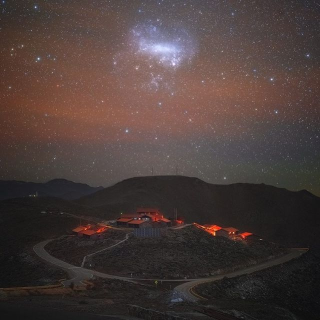 image: The Large Magellanic Cloud, a satellite galaxy of the Milky Way, stands above the southern horizon in this telephoto view from Las Campanas Observatory, planet Earth. In the dark September skies of the Chilean Atacama desert, the small galaxy has an... by astronomypicturesdaily