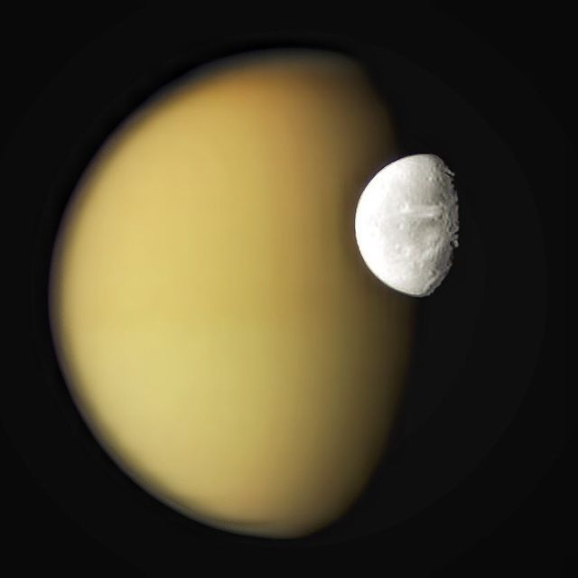 """image: Saturn's Moons Dione and Titan from....""""But if a man walk in the night, he stumbleth, because there is no light in him."""".What would it be like to see a sky with many moons? Such is the sky above Saturn. When appearing close to each other, moons... by thehubblescope"""
