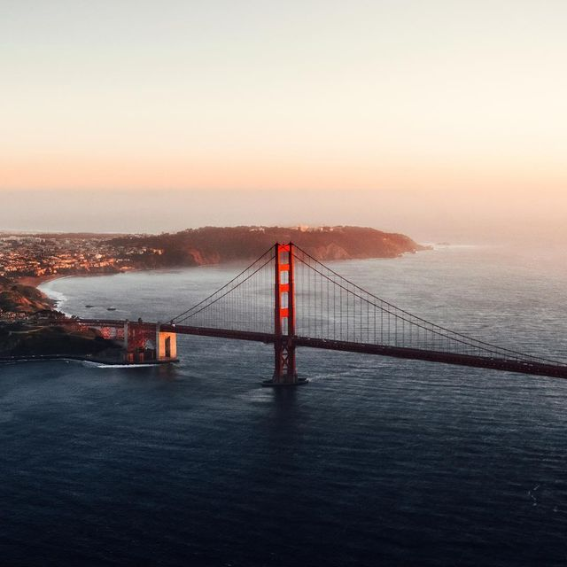 image: watching the golden gate get hit with the last light from a doors off heli flight ? #bigredbridge by kyleohlson