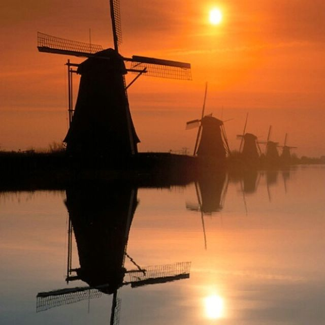 image: Dutch windmills at sunrise by exupery