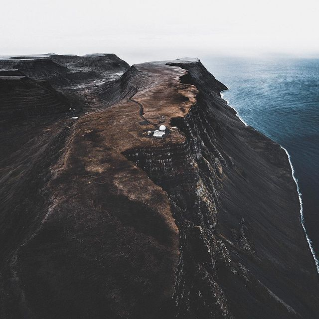 """image: Öðruvísi. Where the ocean flirts with the coast. Cliffs born by carving ice.A landscape unalike the rest of Iceland. """"Öðruvísi""""... meaning """"different"""", describes the Westfjords perfectly. It's massive landscape is raw and untamed with towering... by donalboyd"""