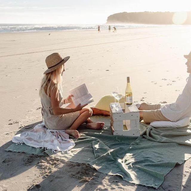image: Some vino and a good read en la playa to celebrate ✨ by tiago_kerber