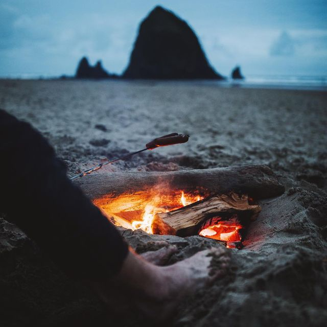 image: A very cold evening at cannon beach, good thing we had the fire to warm our feet and cook some amazing ? by cameronleeanderson