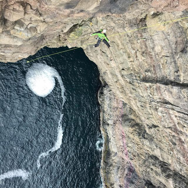 image: @stonerideryuji hovering above a vortex of sea and stone here in the Faroe Islands.  We have found some wonderful and surreal stone to climb on,and the first ascent potential is off the hook!! Yuji, @onceuponaclimb and I all have awesome lines we are... by cedarwright