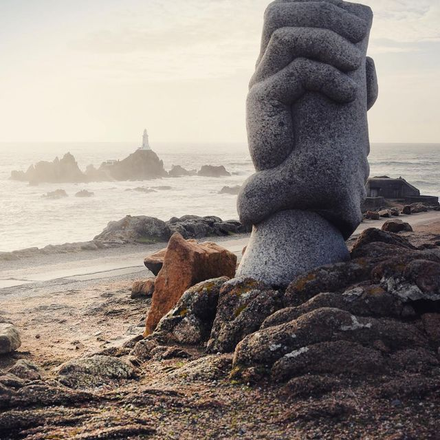 image: A shot of the Saint-Malo sculpture by Derek Tristram overlooking La Corbière Lighthouse, Jersey. It was erected in 1997 to commemorate a rescue that took place in 1995 when French catamaran 'Saint-Malo' struck a rock known as La Frouquie, 900 metres... by mikekus