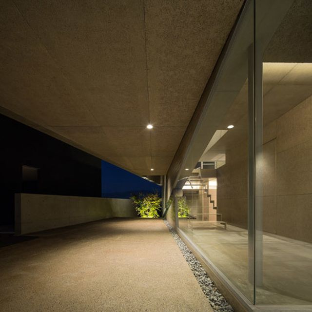 image: Matsuyama Architects builds concrete house on inclin... by hallowedbronze