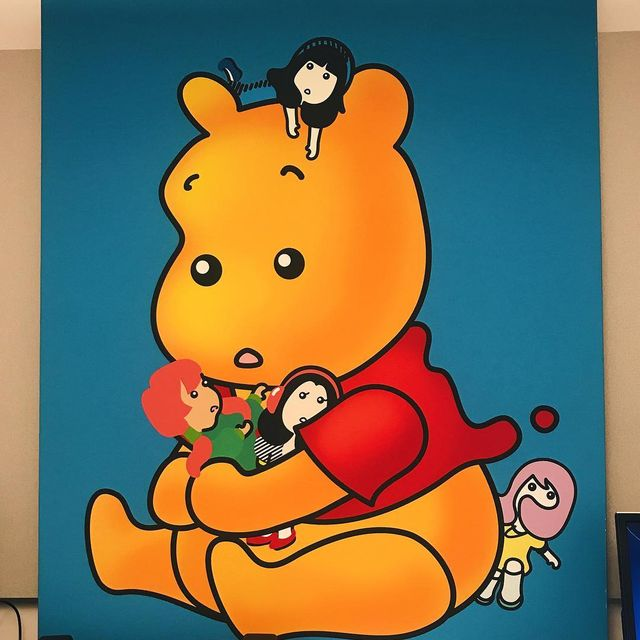 image: Stole this giant piece of Winnie the Pooh art for the drop-in next to my desk. It's so bizarre and amazing ??? by bobbysolomon