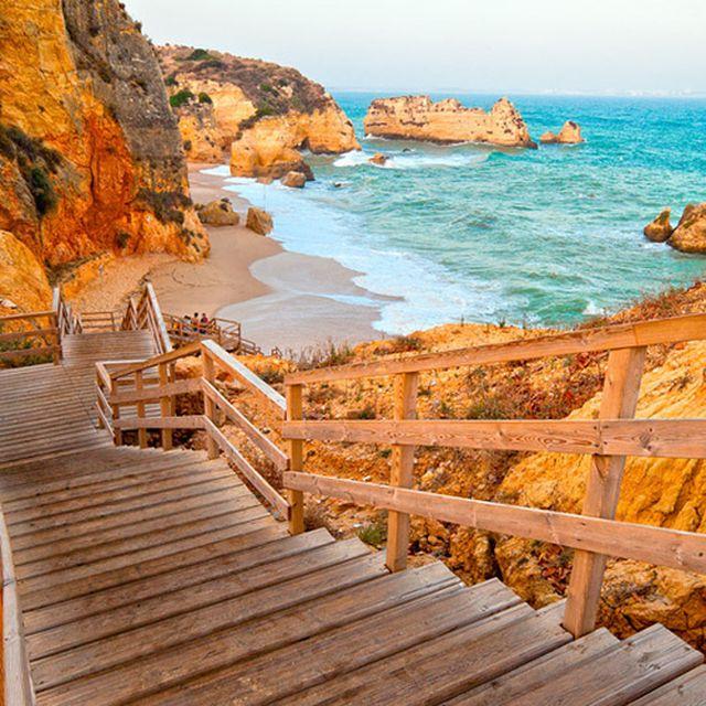 image: Steps to the Sea, Doña Ana Beach, Portugal by cristinavilchez