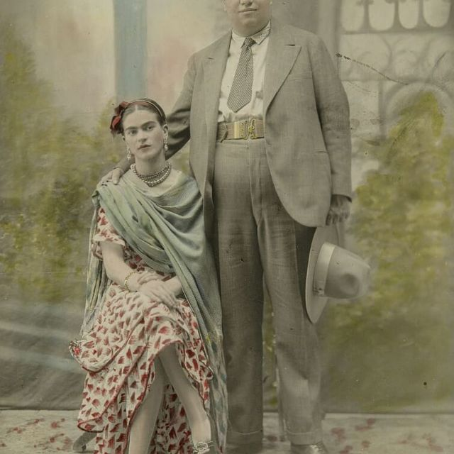 image: Victor Reyes captured this wedding portrait of Frida Kahlo and Diego Rivera upon their first marriage in 1929, which was later printed and hand-tinted with watercolour hues.#saatchigallery #vintage #photography #fridakahlo #diegorivera by saatchigallery