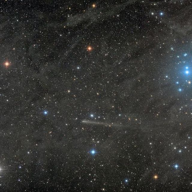 image: Two unusual spots are on the move near the famous Pleiades star cluster. Shifting only a small amount per night, these spots are actually comets in our nearby Solar System that by chance wandered into the field of the light-years distant stars. On the... by astronomypicturesdaily