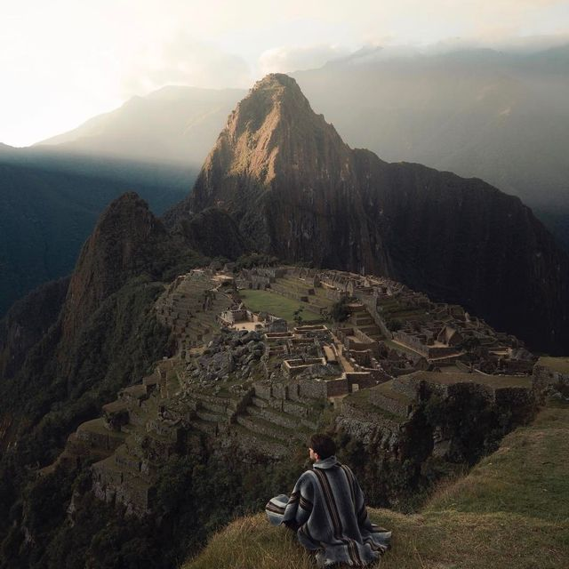 image: I've seen pictures of Machu Picchu but could never have imagined that I would see it with my own eyes. As the sun set below the surrounding mountains these light beams illuminated the smoke from distant fires and lit up the sky. Very fortunate to have... by josiahwg