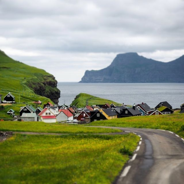 image: The Faroe Islands are full of scenes like this: tiny colorful villages sitting on the edge of the sea. I'll be sharing some of my favorites (along with tips on how to visit them yourself) all month on @trover! Can't wait to share more of one of my new... by dangerousbiz