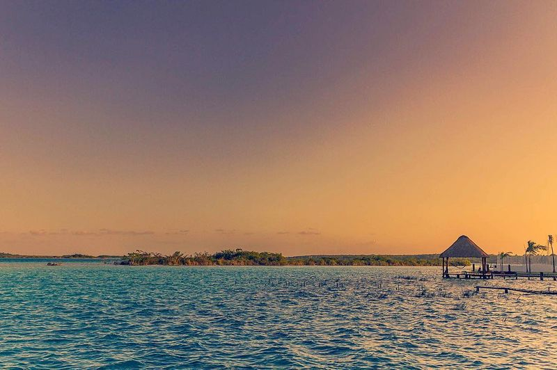 image: Wonderful sunset in Bacalar ❤️....#bacalar #quintanaroo #mexico #mexicolors #mexicoinmypocket #mexicotravel #mexico_maravilloso #mexicodesconocido #ig_mexico #ig_color #ig_shotz #ig_travel #beautifuldestinations #shotzdelight #travellingthroughtheworl by majolophoto