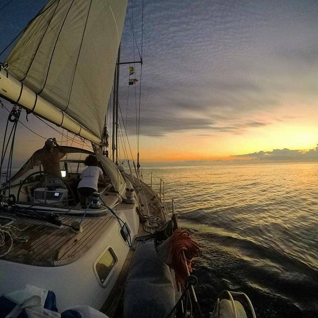 image: In the middle of the ocean, Panama to Galapagos.. Can't ask for a better sunset!!?..? sent to us by @simonemerighetti by sailing_boats