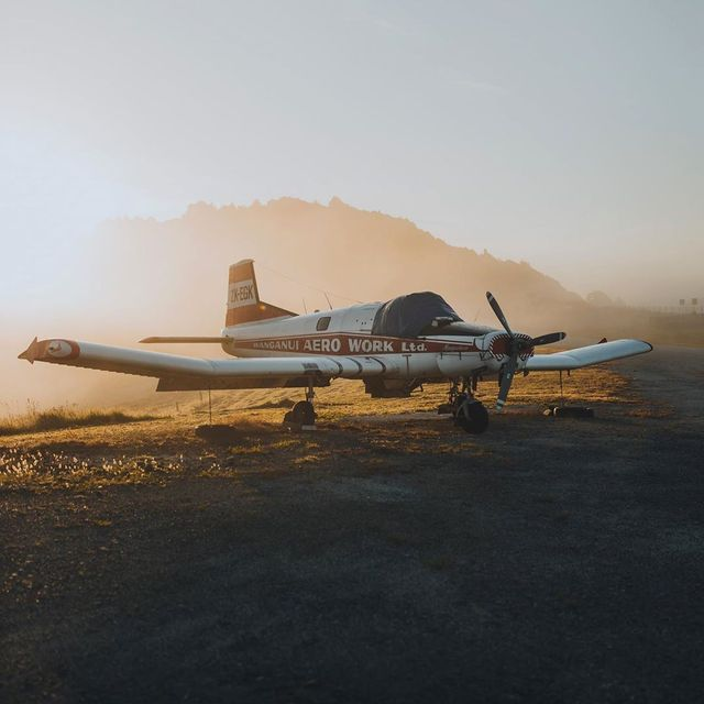 image: It was a foggy morning. I drove for half an hour without seeing more than a meter ahead of me. Suddenly the sun began to break through the fog and I was lucky to find this parked plane 🇳🇿 by Ventura_Sales