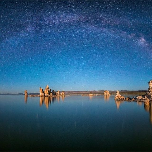 image: Milkyway arching over Mono Lake, California. by seanparkerphotography