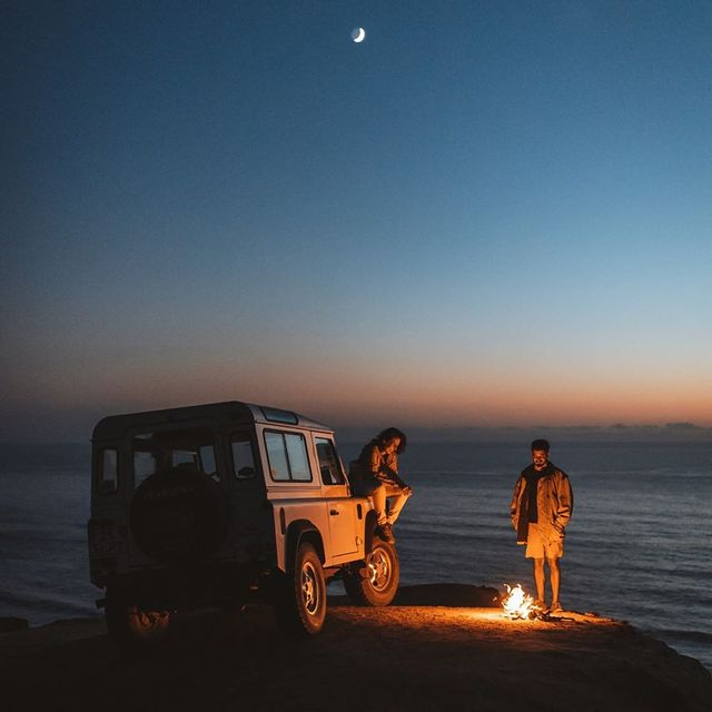 image: Lighting the fire of adventure. This is one of my favorite shots so far. All the things i like are gathered, friends, blue hour, the moon, a beautiful car and the ocean by Ventura_Sales