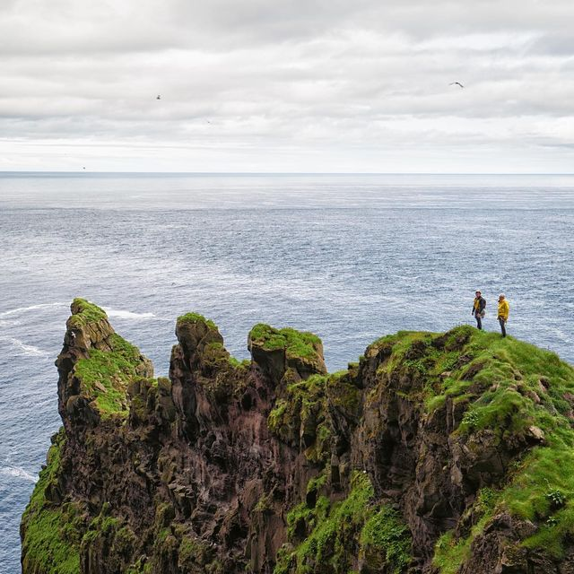 image: Just arrived into the Faroe Islands with @stonerideryuji @onceuponaclimb and @colabcreative to climb one of the biggest and chossiest sea cliffs in Europe.  There are crazy puking birds, more grass than rocks in spots, and some decomposing kitty litter... by cedarwright