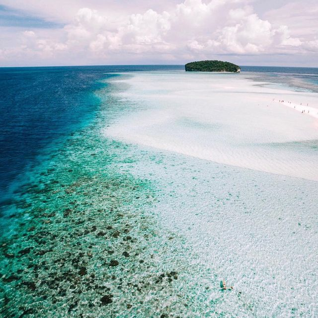 image: Paradise Island ? can you spot the floating human? Drone shot by @_danieltran_ by lauraalycebell