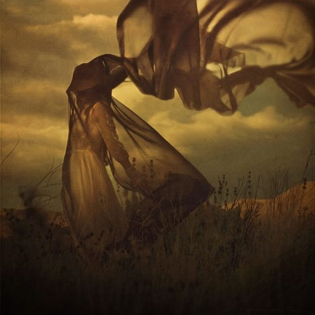 image: I went to the top of a hill on a windy day with this new fabric I had obtained and a hat and went to work creating something experimental. A few days later I was contacted by the producer of a reality TV show saying that they had seen my latest images... by brookeshaden