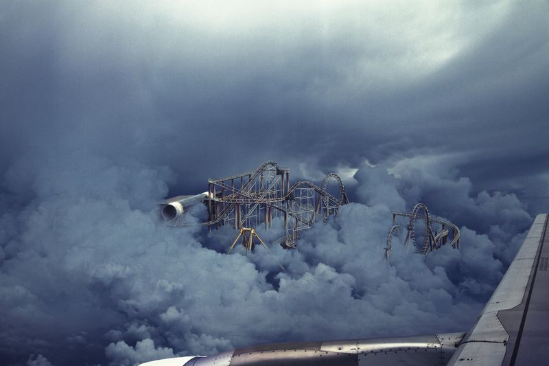 image: Abandoned rollercoaster in the clouds by rusy
