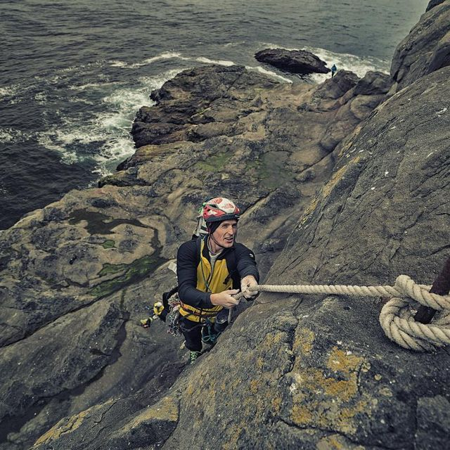 image: James Pearson, aka @onceuponaclimb trusting his life to an ancient rope installed by climbing bird hunters here in The Faroe Islands.  @stonerideryuji James and I used these ropes to access the base of Cape Edinburgh, one of the largest sea cliffs in... by cedarwright