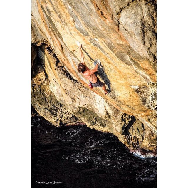 image: Just got home from a few amazing days on my favorite island #mallorca .  All I can think about now is going back to try this beautiful line. A new project is borne!  It's hard to tell in this shot but I'm entering the crux section at around 20 meters... by chrissharma