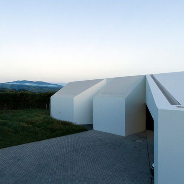 image: Casa Rosto do Cão by M-Arquitectos is fronted by fou... by waryamaranth