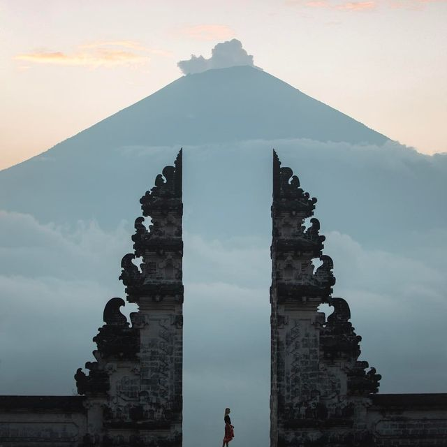 image: We played around in the fog for about an hour, could barely see 20 feet in front of us. As the sun set the clouds dissipated to reveal this giant Volcano that had been watching over us the whole time. What a pleasant surprise. by josiahwg