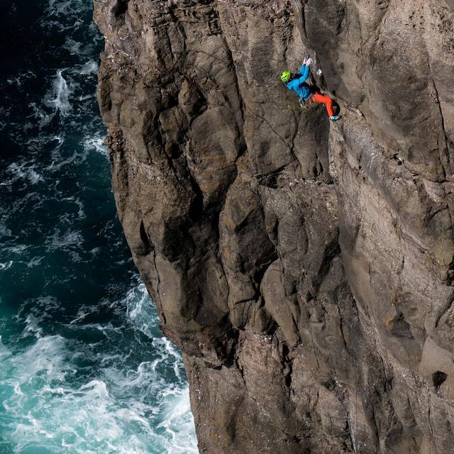 """image: @onceuponaclimb photo of me on my pumpingly awesome new line """"Black Sheep"""" on #Trælanípa here in The Faroe Islands!  This place is so scenic I'm going to have Grams for days! ? @thenorthface by cedarwright"""